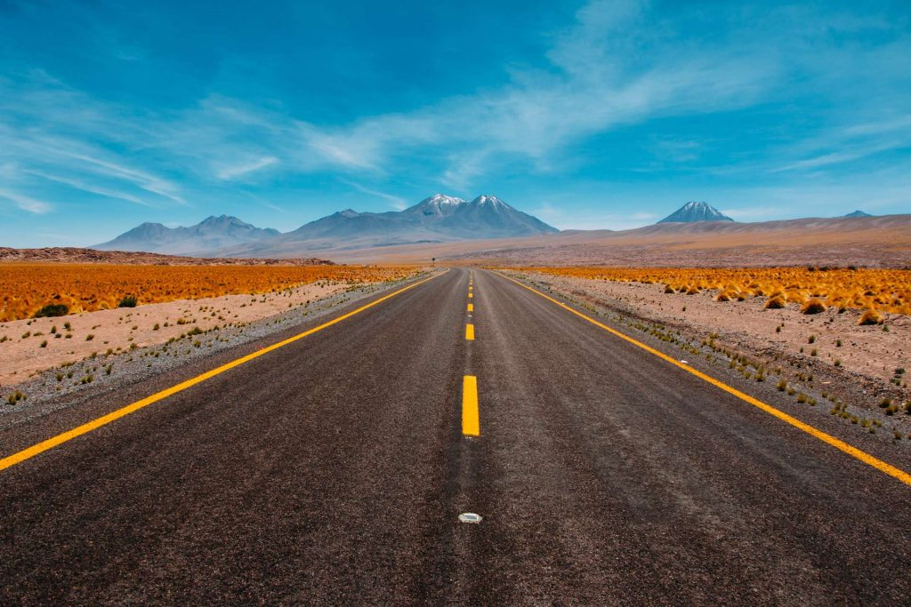empty road - desert road - mountains in the distance