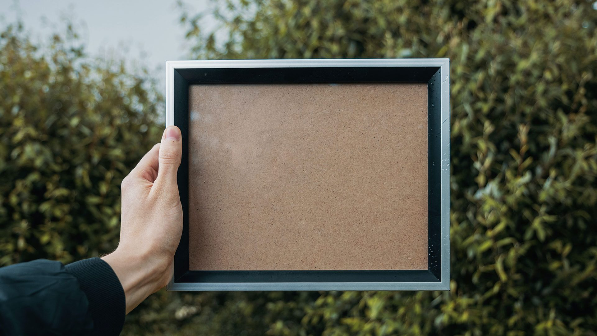 blank frame - person holding a photo frame - white frame with no photo